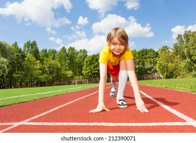 Boy ready to run on road looking straight