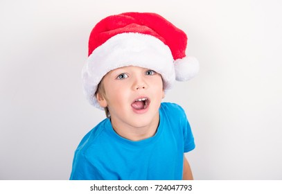 boy in red Christmas hat on white background