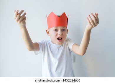 Boy in red paper crown showing weak government concept. Copying behavior model of failure of adult or parent. Education problems concept
