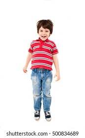 Boy in red striped shirt and blue jeans jumping isolated on white.
