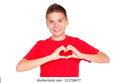 Boy in red tshirt making heart symbol with hands