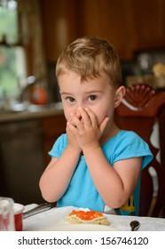 Boy refusing to eat red caviar