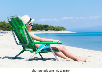 Boy relaxing on beach