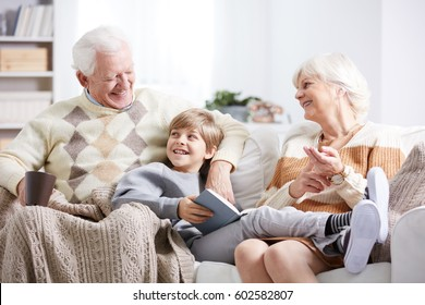 Boy relaxing together with his grandfather and grandmother