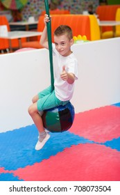 A boy ride on hanging balls