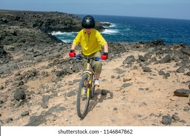 boy riding his mountainbike offroads and doing tricks