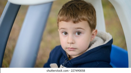Boy riding plastic car