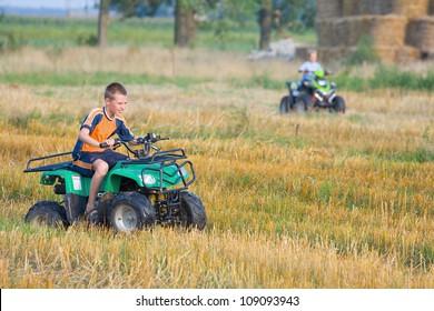 Boy riding a quad bike