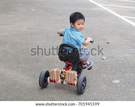 Boy Riding Red Bike School Asian Stock Photo Edit Now 701945599