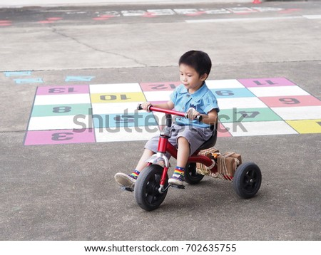 eb6148565a3 Boy riding a red bike in school Asian boy 3 years old Cute boy wearing blue
