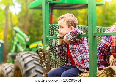 boy riding a tractor on a farm. Hayride. Copy space for your text