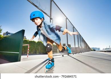 Boy in roller blades doing tricks at skate park