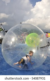 A boy rolling in an inflatable bubble