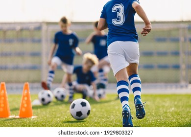 Boy Running on Grass Field in Soccer Cleats. Closeup image on Football Shoes.  Young Boy in Turf Boots for Playing Football on Natural and Artificial Ground