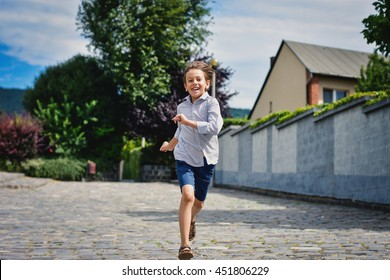 Boy running in the park.
