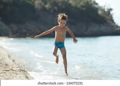 Boy running sea