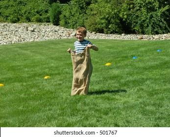 boy in sack race