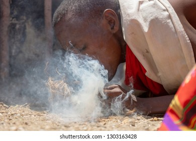 Boy from the Samburu tribe are making a bonfire. Kenya, Samburu, tribe, culture, Africa.