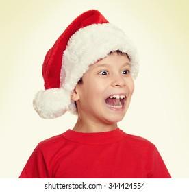 boy in santa helper hat portrait