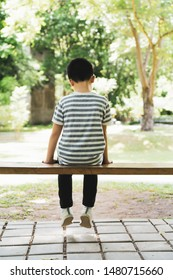 The boy sat sadly alone on the bench