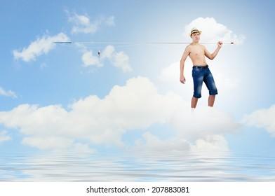 Boy of school age with fishing rod