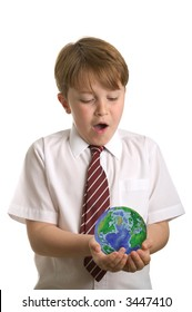 Boy in school uniform holding a globe, isolated on white. Globe from NASA images.