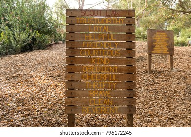 Boy scout laws on wooden sign