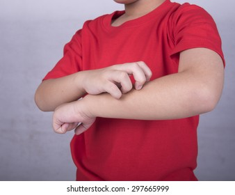 boy scratch the itching skin. Concept of dermatitis allergy mosquito bite.