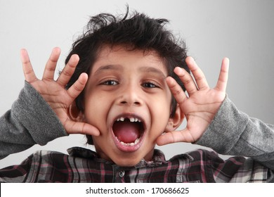 A boy screams with his mouth open