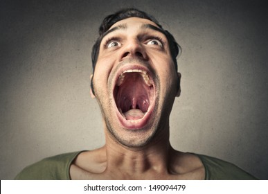 boy screams opening the mouth