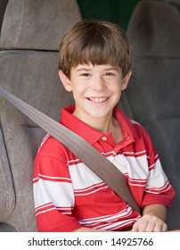 Boy With Seatbelt on Riding in Car