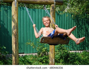 The boy shakes on a swing