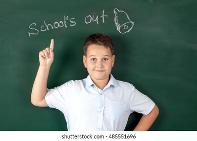 boy in a shirt with school boards with bulb and idea