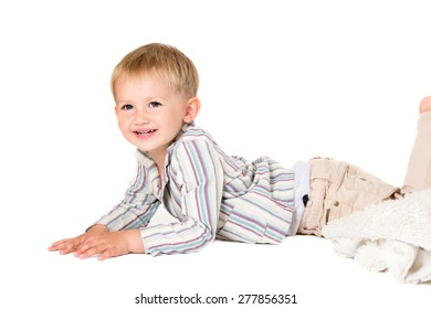 Boy in shirt shot in the studio on a white background