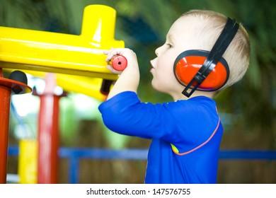 Boy shooting from a toy gun
