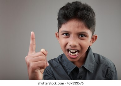 A boy shouts and points his finger