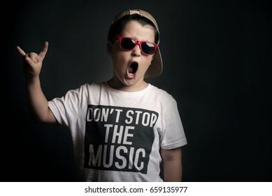 Boy showing rock sigh