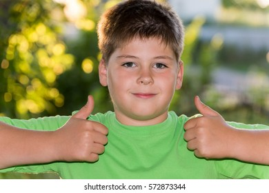 Boy shows gesture that all is a well