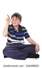 boy shows his finger on a white background