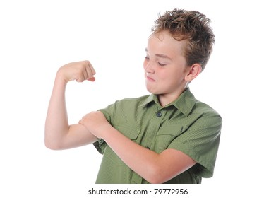 The boy shows his muscles. Isolated on a white background