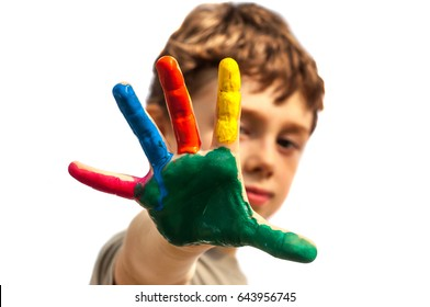 The boy shows the palm painted in different colors. Isolated