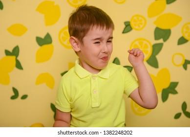Boy Eating Lemon Images, Stock Photos & Vectors | Shutterstock
