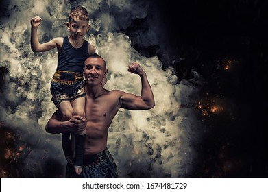 The boy sits on the shoulders of the coach. They celebrate victory. The concept of sports, Muay Thai, kickboxing, mma. Mixed media