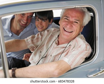 Boy sitting in car with father