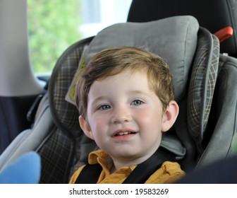 boy sitting in child car seat. shallow DOF