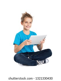 Boy sitting with digital tablet isolated on white background