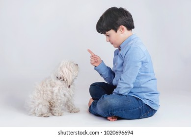 boy sitting with his dog