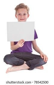 boy sitting and holding a blank white page with copyspace for your text