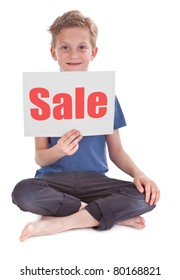 boy sitting and holding white page with sale word