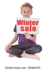 boy sitting and holding white page with winter sale word